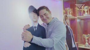 T1 CEO Joe March hugging Faker cutout at T1 gaming facility